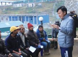 BUILDING BETTER: Community leader Bir Bahadur Ghale speaks about earthquake-resistant building techniques in Barpak last week.